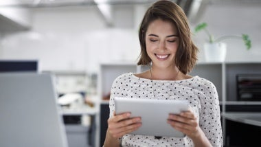 smiling woman on iPad
